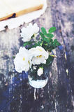 White wild roses in a glass Royalty Free Stock Photos