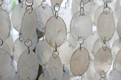 White Wind Chimes. White and silver wind chimes for patterns or background Royalty Free Stock Image