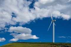 White wind turbine against the blue sky Stock Photo