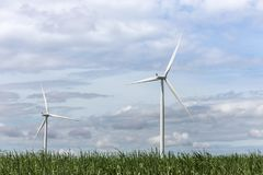 White wind turbines generating electricity in wind power station alternative renewable energy from nature Royalty Free Stock Photography