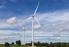 White wind turbines generating electricity in wind power station alternative renewable energy from nature Stock Photos