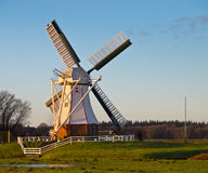 White windmill against blue sky Royalty Free Stock Photography