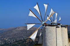 White windmill on blue sky background stock image