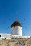 White windmill and blue sky on the island of Mykonos, Greece Royalty Free Stock Images