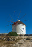 White windmill and blue sky on the island of Mykonos, Greece Stock Images