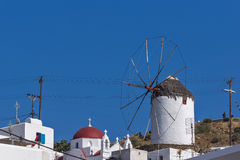 White windmill and blue sky on the island of Mykonos, Greece Royalty Free Stock Photography
