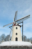 White Windmill on hill in snow Stock Photos