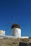 White windmill on the island of Mykonos, Cyclades Islands Royalty Free Stock Photography