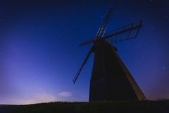 White Windmill in a Low Angle Photography during Nighttime Stock Photography