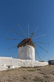 White windmill and medieval wall on the island of Mykonos, Greece Royalty Free Stock Photos