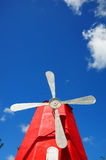 White windmill metal vanes against blue sky Stock Photos