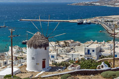 White windmill and Mykonos town, the island of Mykonos, Cyclades Royalty Free Stock Photography