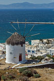 White windmill and Mykonos town, the island of Mykonos, Cyclades Royalty Free Stock Photos