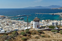 White windmill and Mykonos town, the island of Mykonos, Cyclades Royalty Free Stock Photo