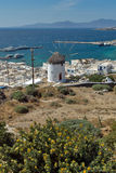 White windmill and Mykonos town, the island of Mykonos, Cyclades Stock Photography