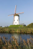 White windmill near river Stock Image