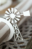 White windmill serviette holder. White paper windmill serviette holder cut from cardboard holding a serviette Stock Images