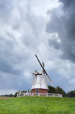 White windmill and stormy sky Royalty Free Stock Photography