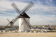 White windmills in Campo de Criptana town, province of Ciudad Real, Castila-La Mancha, Spain Royalty Free Stock Images