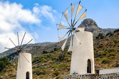 White windmills at Homo sapiens museum in Lassithi district on Crete island, Greece Stock Photos