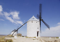 White windmills in La Mancha, near Consuegra, Spain. Stock Image