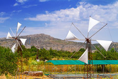 White windmills of Lasithi Plateau on Crete Royalty Free Stock Images