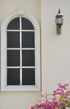 White window. On cream wall Royalty Free Stock Images