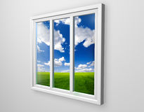 White window. View on green field Royalty Free Stock Photos
