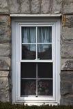 White window on aged rock wall Stock Photos