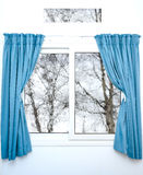 White window with blue curtains on a rainy day Royalty Free Stock Photo
