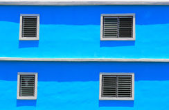White window on a blue wall Royalty Free Stock Photo