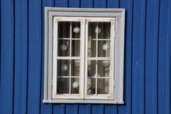 White window and blue wall Royalty Free Stock Photos