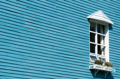 White window on blue wooden wall Stock Image