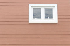 White Window on brown wooden wall Royalty Free Stock Photo