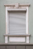 White window closed grey roller shutters. Stock Photography