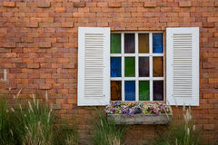 White window with colorful glass. White glass windows opening on to a colorful and beautiful Royalty Free Stock Images