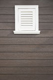 White window on dark brown plank wall, Vintage Background Textur Royalty Free Stock Images