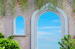 White window and door reflecting blue sky and cloud Royalty Free Stock Images