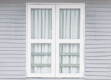 White window doors on old gray wooden houses.  royalty free stock images
