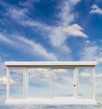 White window floating in the sky. Royalty Free Stock Image