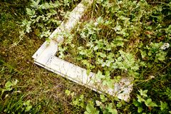 White window frame abandoned in the grass royalty free stock image