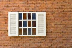 White window with old red brick wall Stock Images