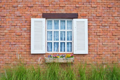 White window and red brick wall Stock Photos