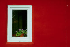 White window on a red wall on the street.  Stock Photography