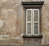 White window shutters. Old window in an Italian city of Bergamo, Lombardy Royalty Free Stock Image