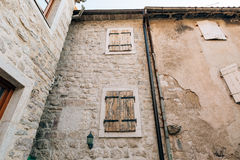 White window shutters. The facade of houses. In Montenegro Stock Photography