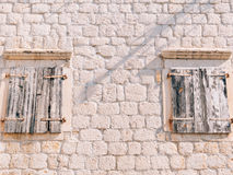 White window shutters. The facade of houses. In Montenegro Royalty Free Stock Images