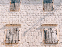 White window shutters. The facade of houses. In Montenegro Stock Photo