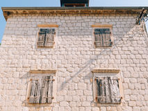 White window shutters. The facade of houses. In Montenegro Stock Image