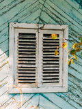 White window shutters. The facade of houses. In Montenegro Stock Images